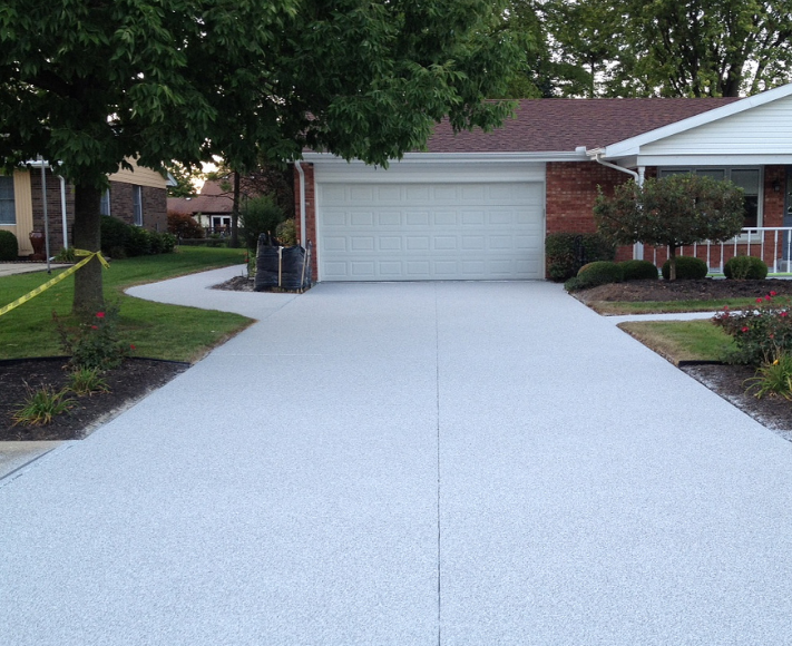White brooms finished concrete driveway in Lansing, Michigan.