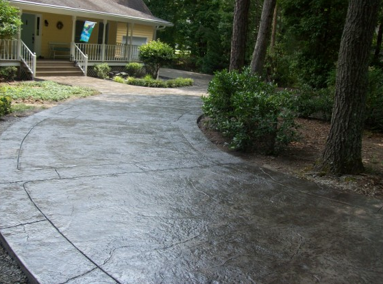 Lansing, Michigan photo of a stamped and stained concrete driveway.