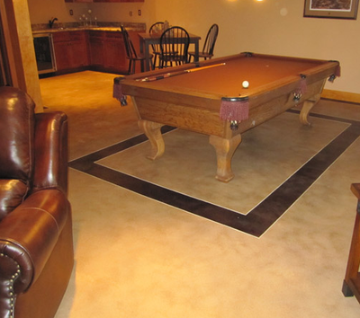 Basement concrete floors with a billiards table in Lansing, Michigan.