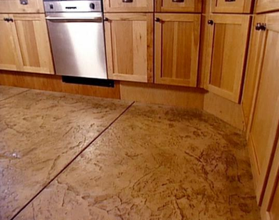 Kitchen in Lansing, Michigan with stamped and stained concrete floors.