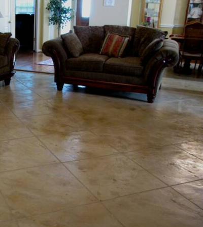 Living room in residential home in Lansing, Michigan with stamped concrete floors.
